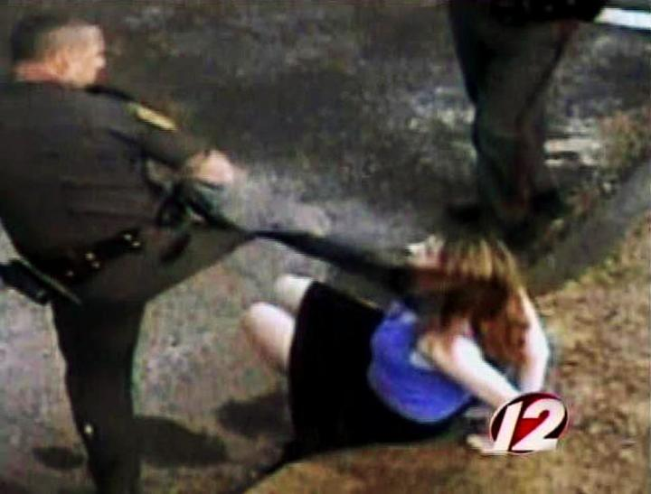 Cop kicks handcuffed woman in the face
