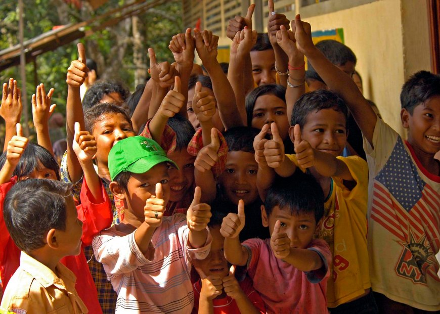 050117-N-9951E-190Region of Glebruk, Sumatra, Indonesia (Jan. 17, 2005) Ð Indonesian children give a thumbs-up in celebration of relief aid near the town of Glebruk, one of the many coastal towns on the island of Sumatra, Indonesia hit by the Tsunami that struck South East Asia December 26, 2004. Members from the United Nations (UN), USAID, the Office of Foreign Disaster Assistance (OFDA), the Disaster Assistance Response Team (DART), and the World Health Organization (WHO) are conducting surveys in the region of Banda Aceh, Sumatra to determine the needs of Indigenous Displaced Persons (IDPs), the victims of the Tsunami that struck South East Asia. U.S. Navy photo by Photographer's Mate 2nd Class Elizabeth A. Edwards (RELEASED)